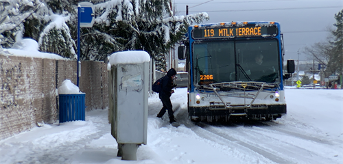 A Route 119 bus picks up a customer on a snowy February 2019 day.