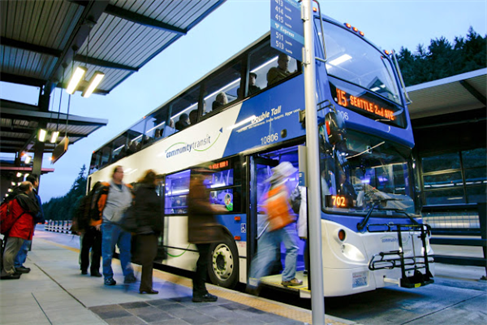Customers board a Double Tall bus at a Mountlake Terrace Freeway stop