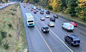 A ST double decker bus drives on the shoulder of I-5 southbound near Mountlake Terrace