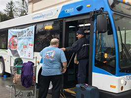 Volunteers stuff a bus with donated items in December 2016