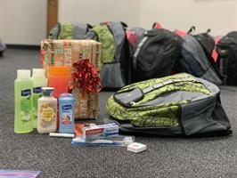 Backpacks for homeless students filled with gifts and hygiene items.
