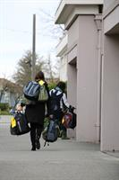 Community Transit employees delivering backpacks for homeless students at Everett High School.