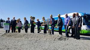 Officials shovel dirt at the Swift Green Line groundbreaking event