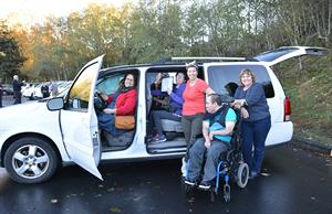 Members of Young Life Capernaum Snohomish County settle into their new van.