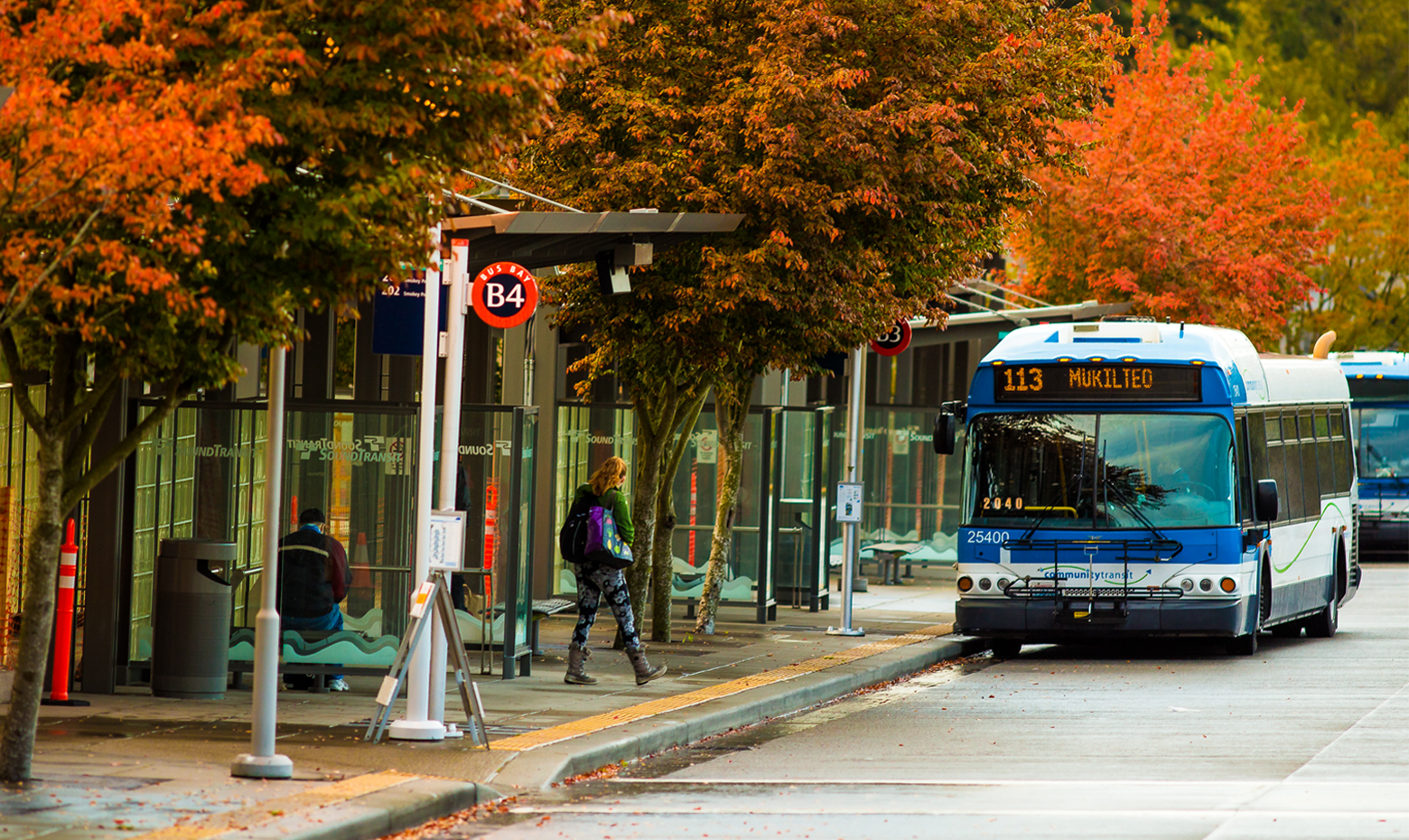 Autumn leaves serve as the background behind a Community Transit bus at Lynnwood Transit Center
